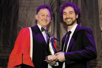 John Zorbas accepts his award from AMA (WA) president Michael Gannon.