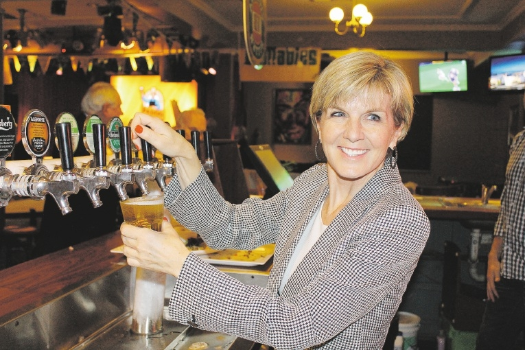Foreign Affairs Minister Julie Bishop pours a cold one. Picture: Caitlin Tiller