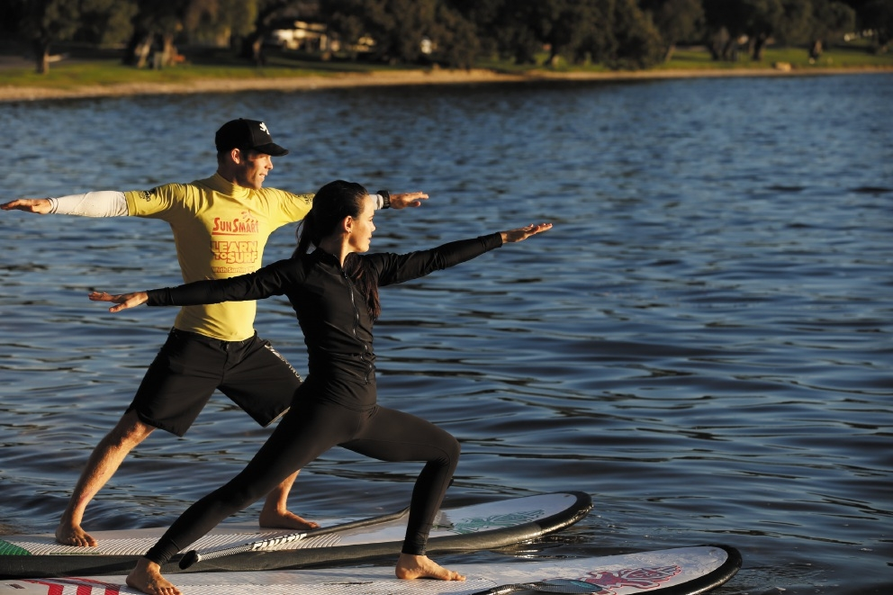 Perth Stand-Up Paddle School owner Cameron McKay and instructor Tess Barretto. Picture: Andrew Ritchie           d442887