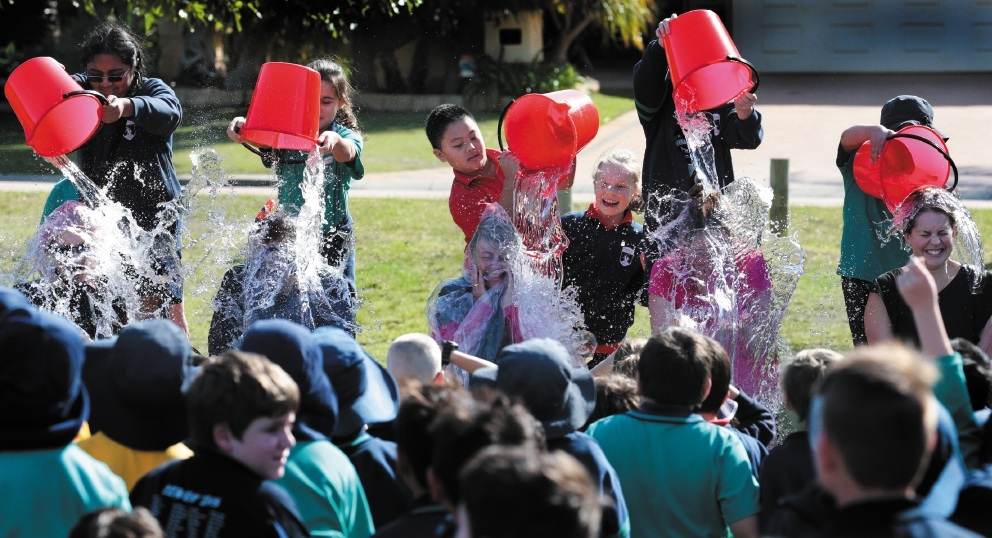 Teachers and students taking part in the charity bucket challenge. Picture: Martin Kennealey www.communitypix.com.au   d442234