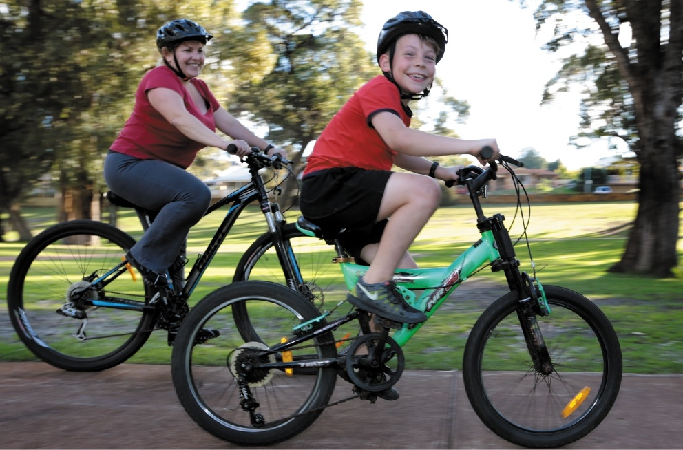 Riding for someone who can't: Claire Wilson and her son Dylan (8). Picture: Martin Kennealey         d442723