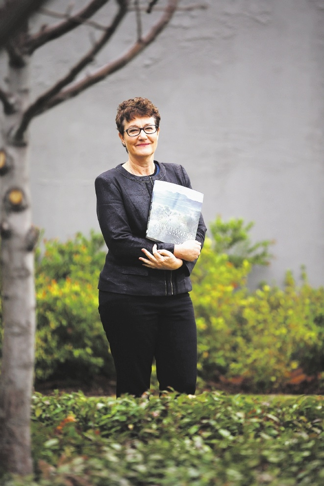 Journalist and author Victoria Laurie with her new book, The Southwest. Picture: Andrew Ritchie        www.communitypix.com.au   d441469