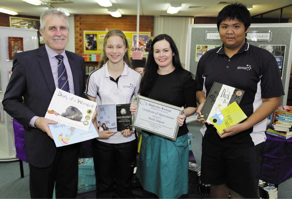 Principal Peter Noack, Perth Airport's Fiona Lander and  college students Ebony Lang and Matthew Estacio.