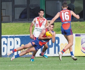 Aaron Black takes a diving mark against South Fremantle.        Picture: Dan White
