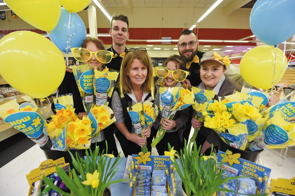Daffodil Day supporters (front, from left) Kay Tuckerman, Fiona Wilson, Kayla Burnett and Katelynn Perham with (back, from left) Ben Vivian and and Mike Leeder. Picture: Jon Hewson        d442561