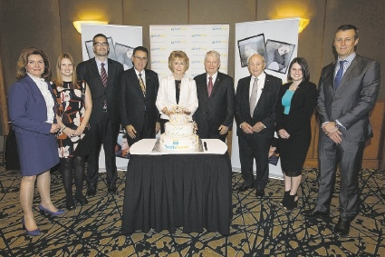 Governor Kerry Sanderson (centre) cutting the cake at the Youth Focus 21st birthday at the Hyatt Regency last week.