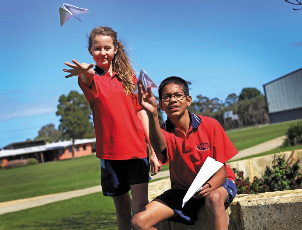 Year 7 students Ryan Castello and Simisa Briggs taking part in the paper plane competition.