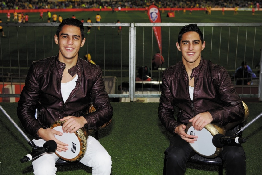 The Subih Brothers performing at Domain Stadium during the AFL multicultural round.