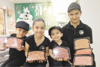 Luigi Mammone (right) with his children Angelo, Georgia and Luigi Jnr and their winning meats.