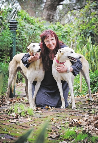 Tania Elliott with foster greyhounds Darby and Joan. Picture: David Baylis www.communitypix.com.au d442058