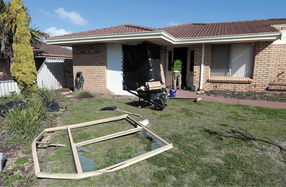 The window frame of the damaged house lies on the front lawn of the Connolly property.  Pictures: Martin Kennealey www.communitypix.com.au   d442425
