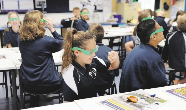 Year 6 student Kaylah Finch and classmates are amazed at what they can discover through science.  Picture: Martin Kennealey         d442209