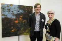 Emerging Artist Award winner Matthew McAlpine with his work The Dark Heart of the Land and South Perth Mayor Sue Doherty.