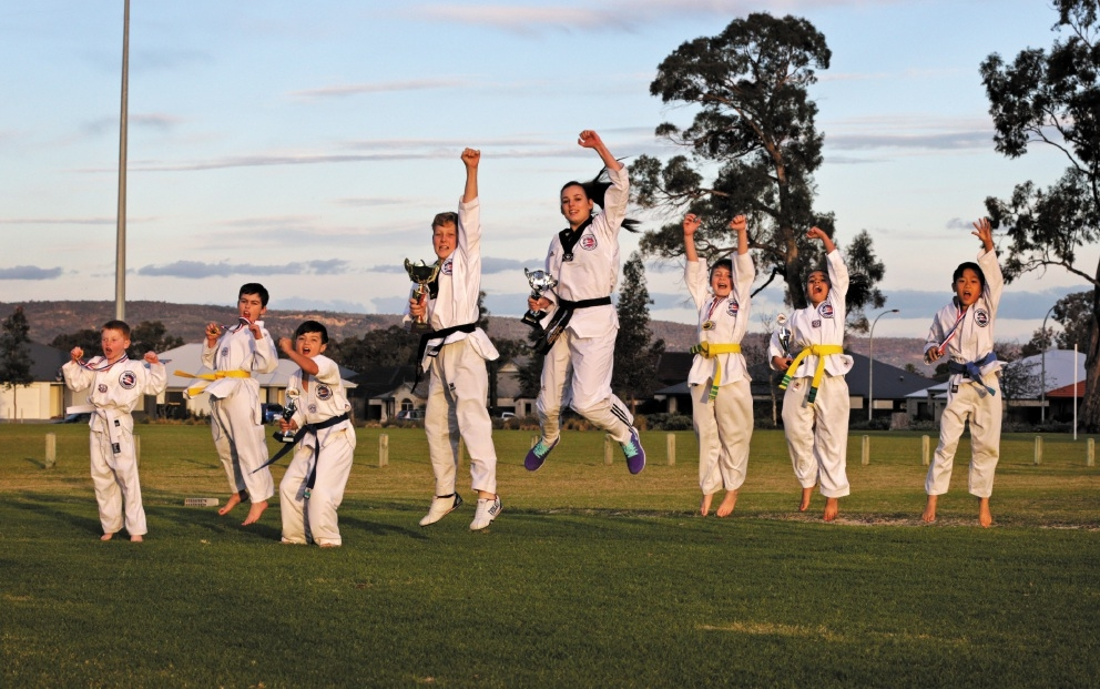 Rawlins Taekwondo club members celebrate their win at the state championships. Picture: David Baylis www.communitypix.com.au d441710