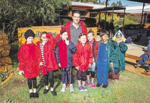 Tim Guest with some of the students from Gosnells Primary in their new uniforms.