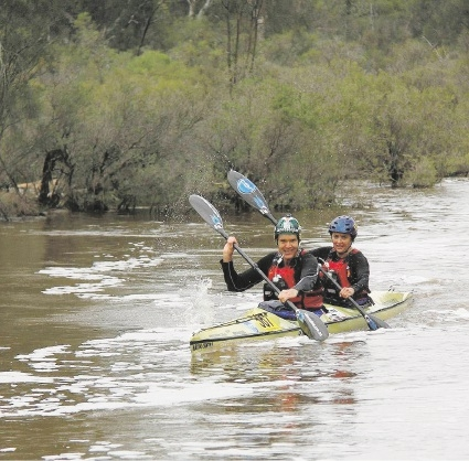 Wendy White and husband Kevin paddle hard to achieve victory during the Avon Descent.