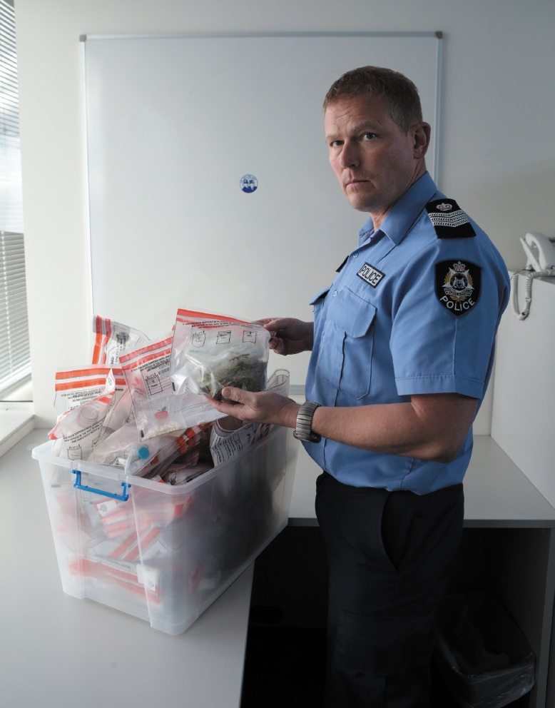 Sergeant Darren Lumb with drugs collected in a week.