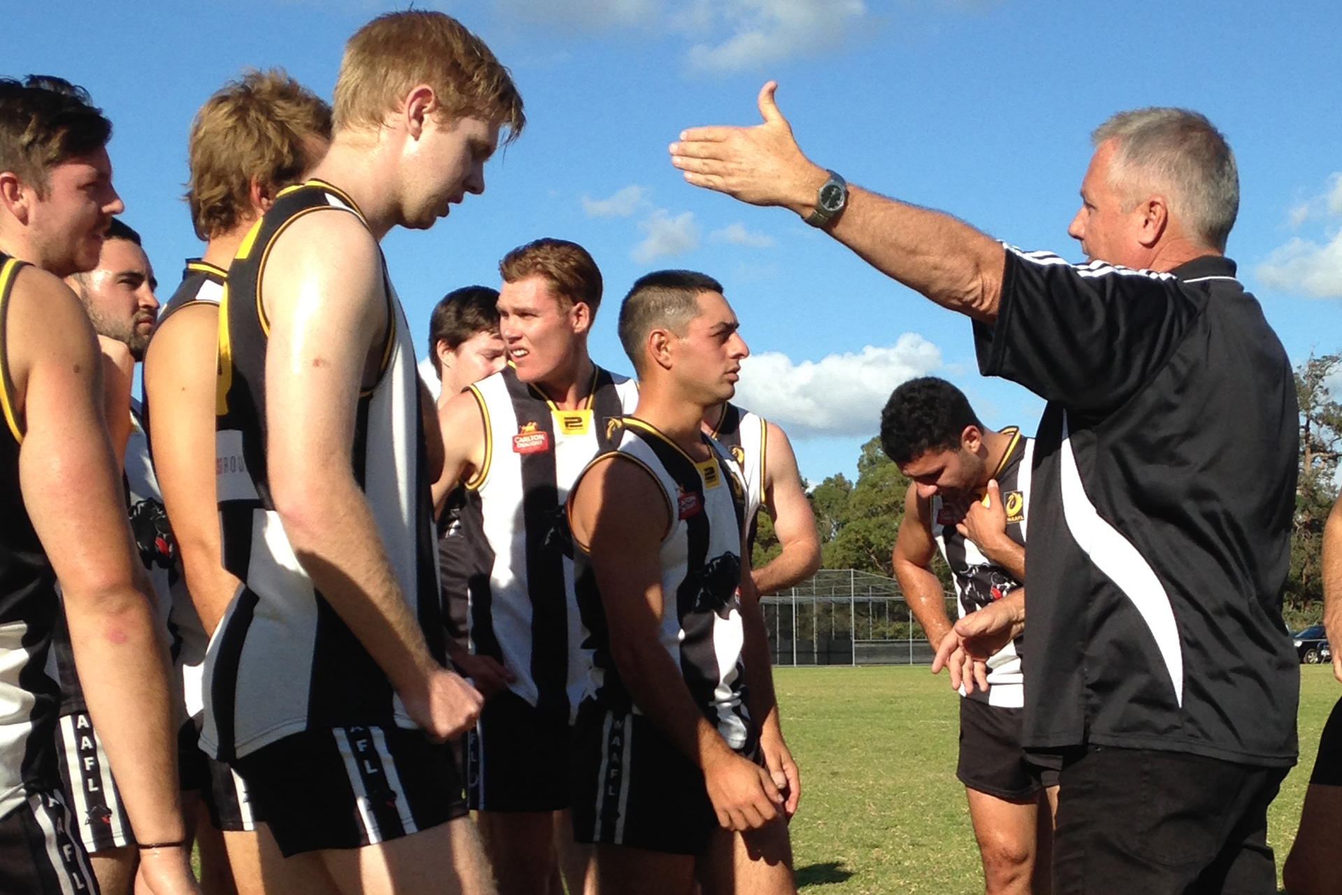 Assistant coach Mick Outridge addresses his charges.