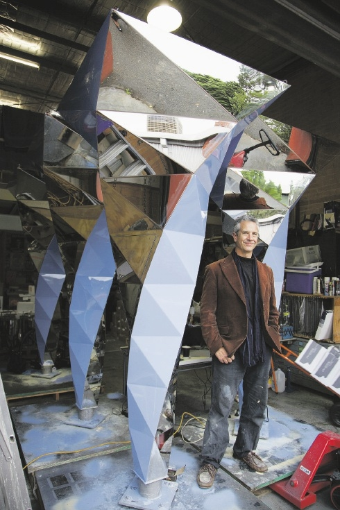 Artist Geoffrey Drake-Brockman in front of the as-yet-unfinished Interlace water sculpture.