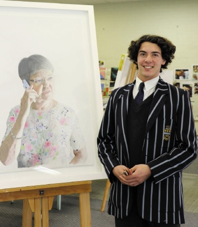 Toby Hills with his winning portrait of his grandmother.
