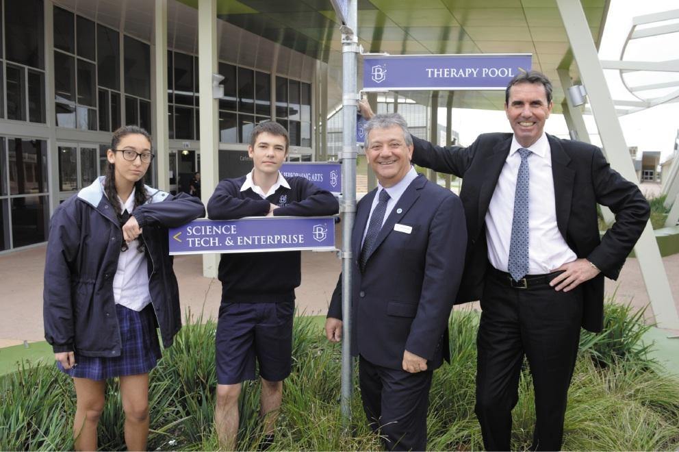 Year 9 students Alisha Saez and Alex Endell with principal Armando Giglia and Education Minister Peter Collier.