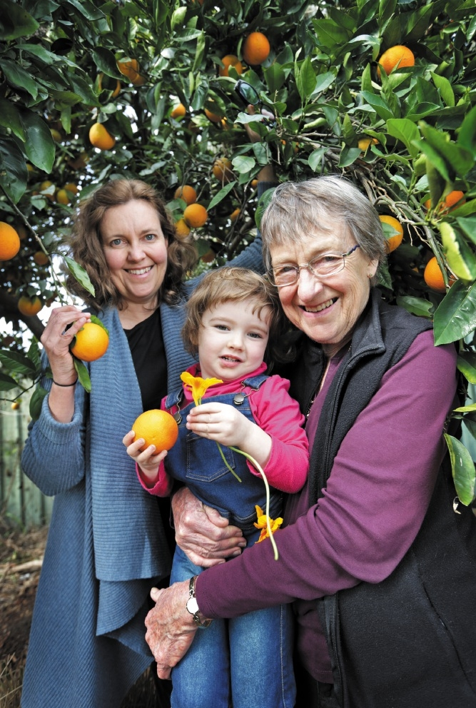 Rachael Roberts with volunteer Glenys Davies and her grand-daughter Charlotte Knox Bolleter. Picture: David Baylis           d441752