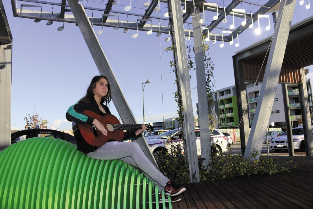 Hannah-Rose Skonis with her guitar at the new busking area.