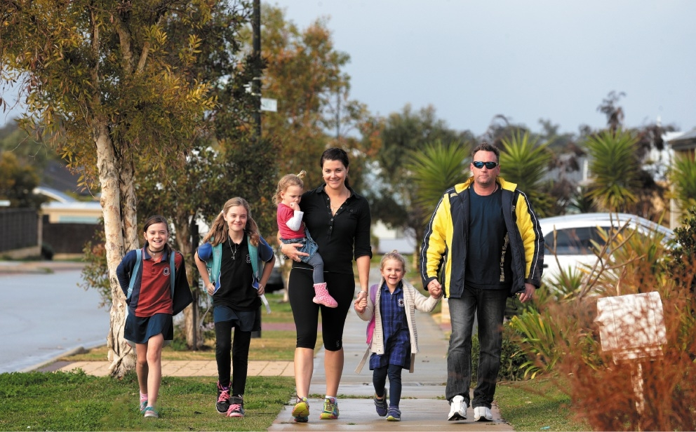 Alana and Shane Davis, of Butler, with their children Charlotte (9), Miliani (11), Caylee (2) and Abby (4). Picture: Martin Kennealey  d441199