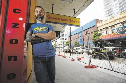 Michael Petrusich owner of ComicZone has been affected by Barrack St road works.Picture: Andrew Ritchie        www.communitypix.com.au   d441593