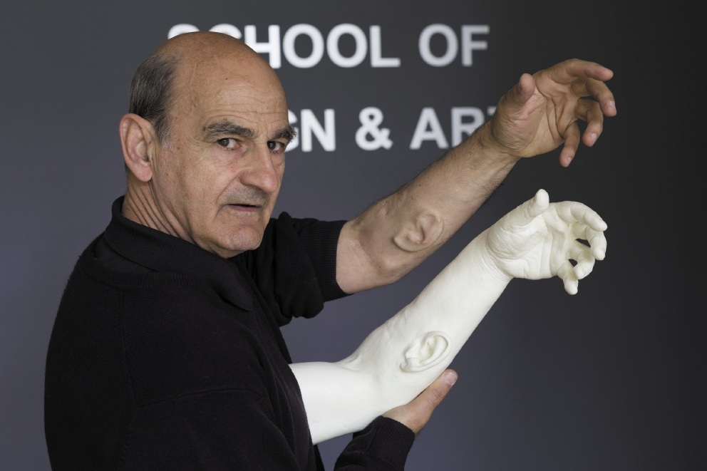 Curtin University professor and performance artist Stelarc with his ear on his arm.