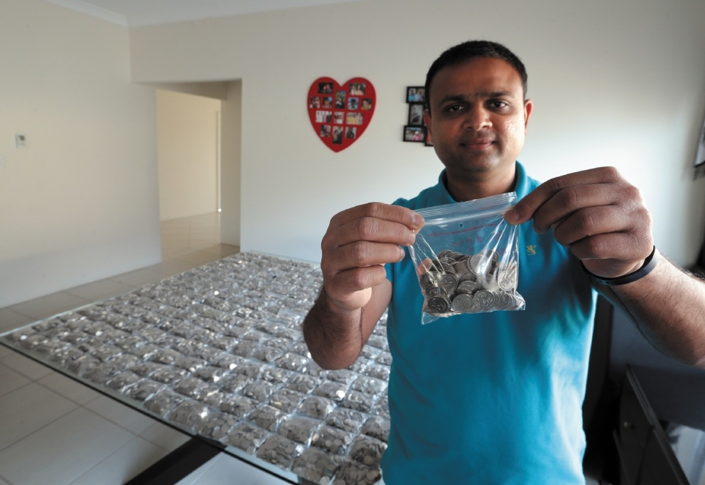 Samirbhai Patel with his 48,000 five-cent coins. Picture: Martin Kennealey        d441681