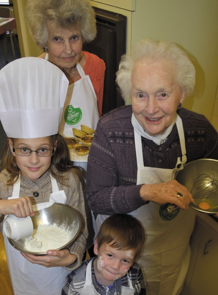 Jacqueline Hanna, Rosalie (9) and Alexander (4) Grieve and Lorna Dudley prepare for the bake off.