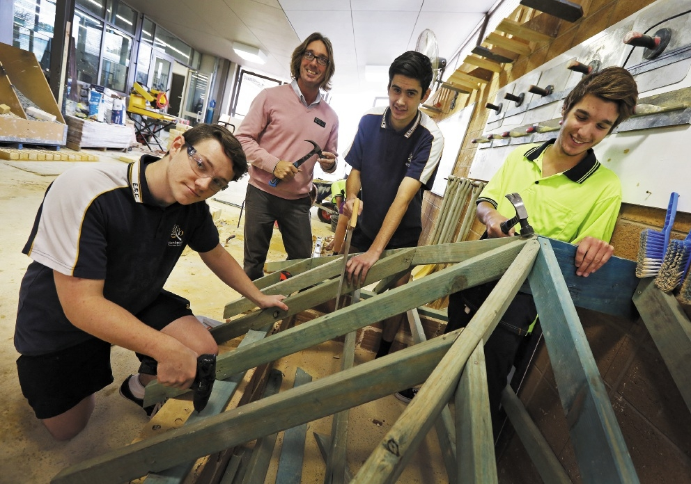 Students Joseph Wright, Braedon Ahuriri, Teacher Jeffrey Imrie and Shaun Rubesa. Picture: Matt Jelonek. d441306a