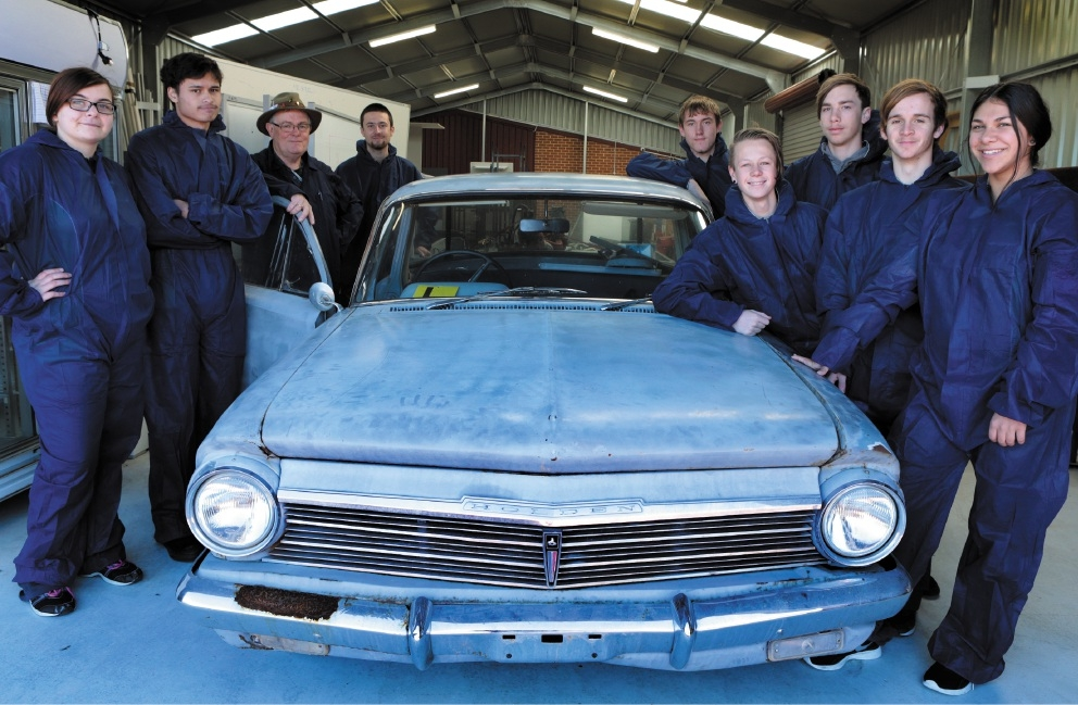 Design and Technology teacher Tom Adams with Year 12 students Meg Robinson, Bobby Potter, Damon Eddie, Luke Willemsen, Jack McDonald, Rob Roach, Ben Darbyshire and Ebony Paul. Picture: Martin Kennealey          d441550