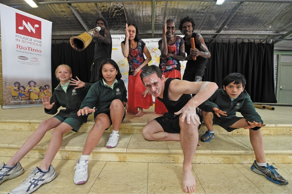 Winthrop PS Year 5s Remy Wegner, Jamie Tan and Brian Clarke with dancers Tony Ganambarr, Shae Duncan, Rodney Beatty (front) and Heather and Edwin Burarrwana.