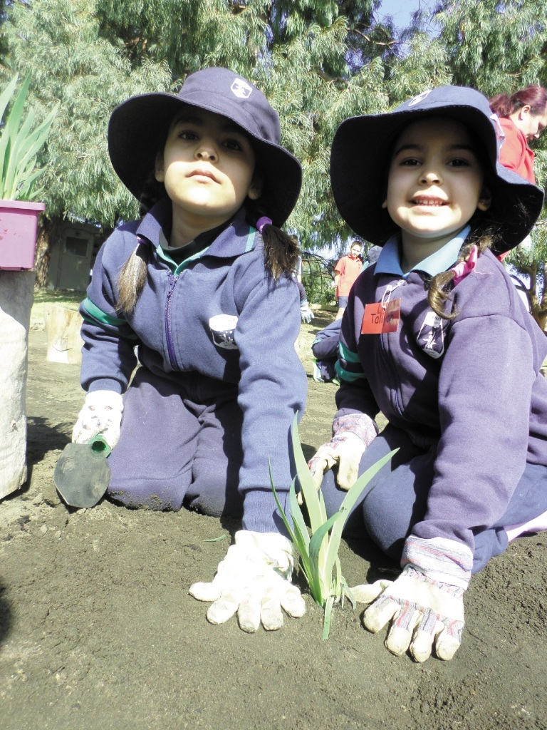 Hands on with planting Taliyah Baxter and Ariana Olomi