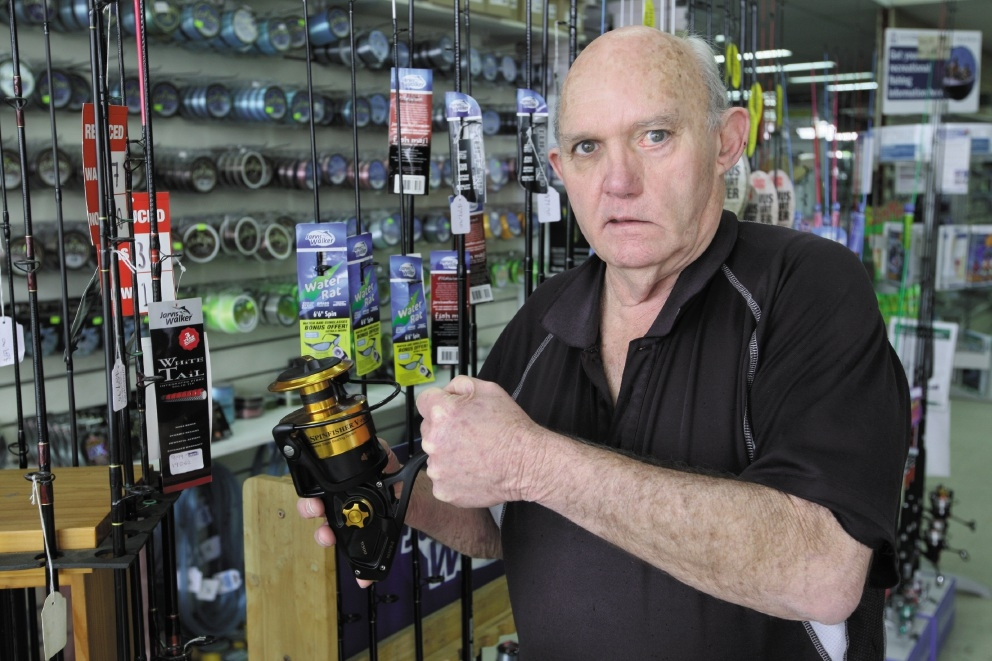 Graeme Harris with a Shimano reel that can be bought online for half what he charges, undercutting his business enormously. Picture: Bruce Hunt www.communitypix.com.au   d423384