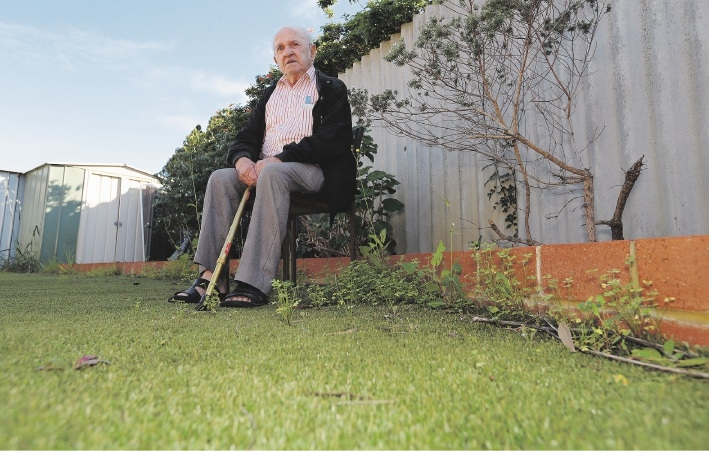 Bruno Gori's artificial lawn is not the 'low-maintenance' |addition to his garden he was told it would be. Picture: Martin Kennealey www.communitypix.com.au   d441087A MARANGAROO resident has been dismayed to find weeds sprouting in his fake grass.