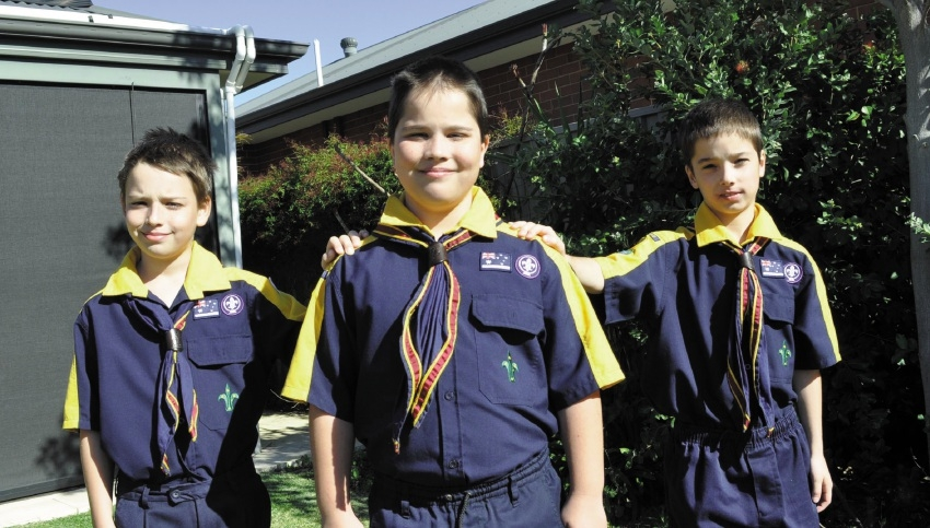 Nine-year-old triplets Nicholas, Ryan and Liam enjoy participating in Scouting activities, thanks to KidSport.