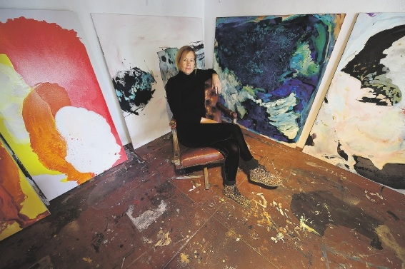 Bec Juniper with some of her paintings.  Picture: Jon Hewson www.communitypix.com.au   d440424