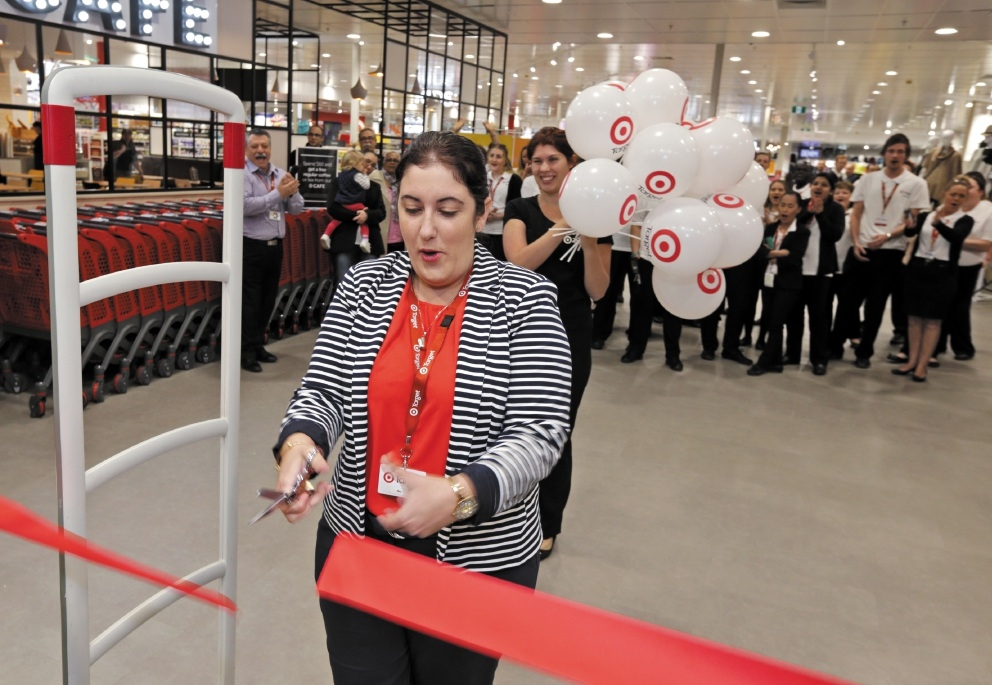 Store manager Bec Curtis cuts the ribbon. Picture: David Baylis    d439870