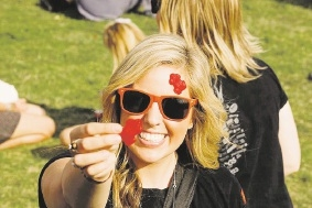 Red Frogger Ella Henry uses red frog lollies to help share party safe messages with youth during leavers.