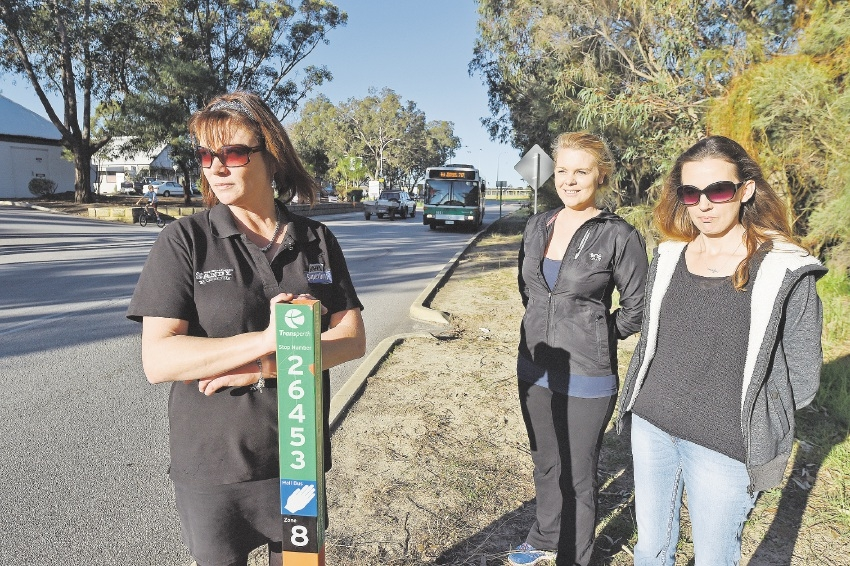 Mums Leah Cheeseman, Kelly McLeod and Deanne Aitchison are concerned that bus stops on South Yunderup Road are not safe. Picture: Jon Hewson  www.communitypix.com.au   d439889