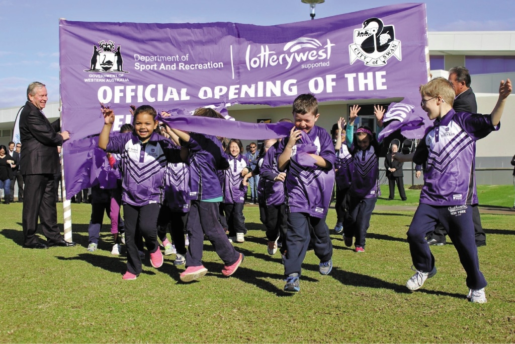 Top: Year 1 students from Ellenbrook Primary School break through the opening banner. Above left: The Ellenbrook District Open Space. Above right: Premier Colin Barnett at the opening ceremony.