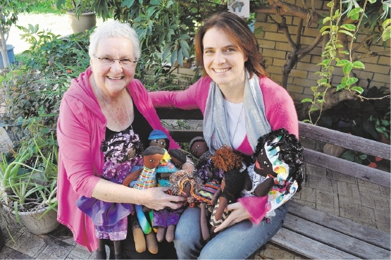 Gosnells resident Marlene Rozentals and her daughter Natasha Yorke with some of the dolls they have made.