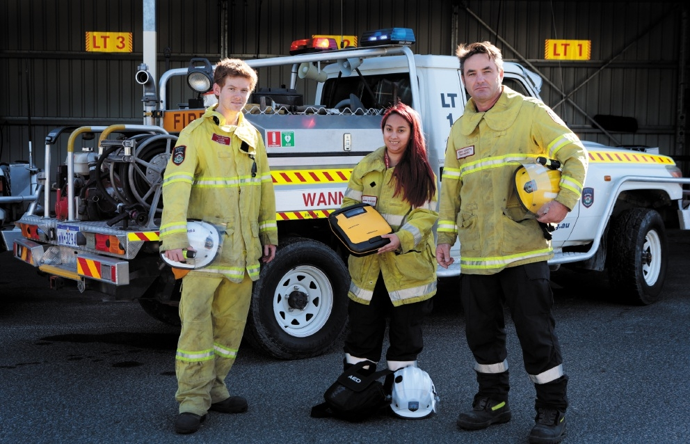 Volunteer firefighters Struan Graham, Monique Van Den Elzen and Renny Gosatti with the defibrillator bought from last year's fundraiser. Picture: Martin Kennealey        www.communitypix.com.au d441671