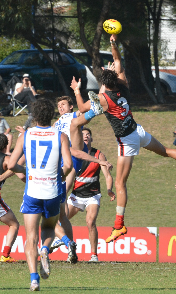 Angus Graham jumps high to get the ball for the Demons in their clash against East Fremantle. Picture: Kerrie-Ann Pendal
