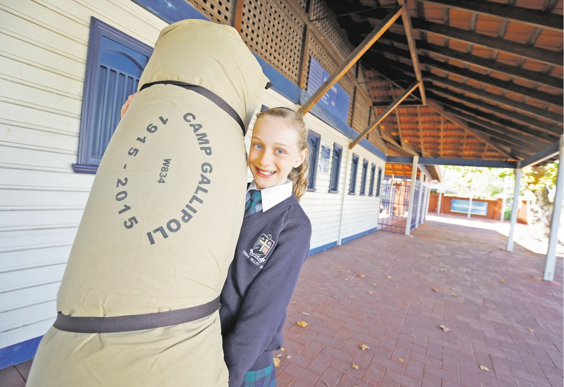 Taylor Racey (10) of Swan Valley, with her Camp Gallipoli swag at the gates to Ascot Racecourse. Picture: David Baylis        www.communitypix.com.au   d436387