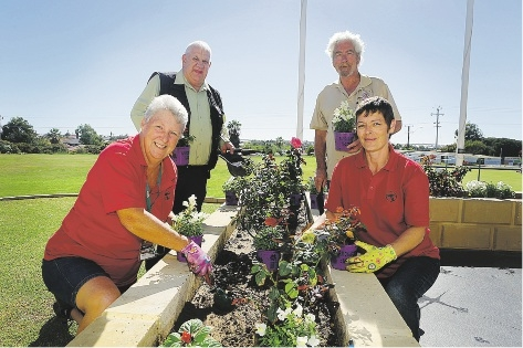 From left: Julie Otremba, RSL president Peter Lofdahl, memorial co-ordinator John Spargo, and Claire Deards add  some potted colour to the RSL garden beds.         d435831