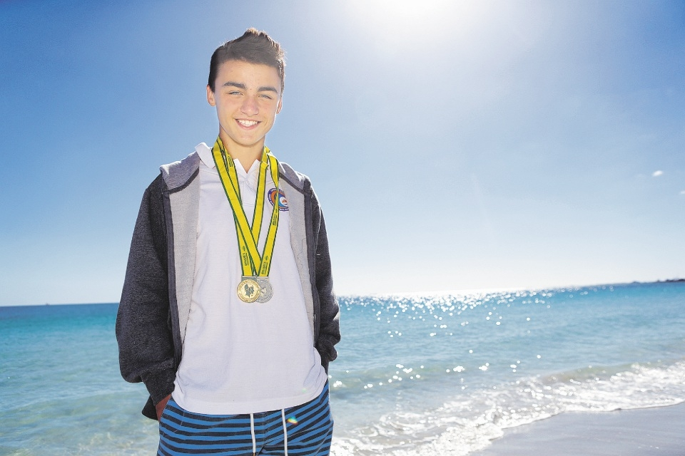 A happy Jack Musika with his medals. Picture: Martin Kennealey    d436312